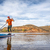 stand up paddling on mountain ake stock photo © pixelsaway