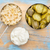 sauerkraut cucumber pickles and yogurt   popular probiotic fermented food   three measuring cups ag stock photo © pixelsaway