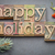 happy holidays in wood type stock photo © pixelsaway