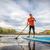 stand up paddling on mountain lake stock photo © pixelsaway