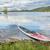 red sup paddleboard on lake shore stock photo © pixelsaway