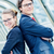 business partners posing back to back stock photo © pixinoo