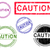 5 grunge stamps   caution stock photo © pokerman