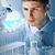 dedykowane · naukowy · pracownika · poważny · młody · człowiek · rękawice - zdjęcia stock © pressmaster