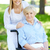 verpleegkundige · ouderen · rolstoel · glimlachend · camera · vrouwelijke - stockfoto © pressmaster