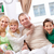 przyjazny · rodziny · młodych · cztery · posiedzenia · sofa - zdjęcia stock © pressmaster