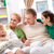 szczęśliwą · rodzinę · młodych · rodziny · cztery · posiedzenia · sofa - zdjęcia stock © pressmaster
