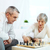 casal · de · idosos · jogar · xadrez · casa · sorrindo · vitória - foto stock © pressmaster