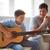 padre · jugando · guitarra · tiro · sonrisa · ninos - foto stock © pressmaster