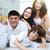 familia · feliz · casa · familia · cuatro · mirando · cámara - foto stock © pressmaster