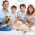 wesoły · rodziny · domowych · posiedzenia · sofa · domu - zdjęcia stock © pressmaster