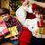 erkek · hediyeler · fotoğraf · mutlu · bakıyor · kamera - stok fotoğraf © pressmaster