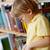figyelmes · iskolás · fiú · olvas · könyv · könyvtár · iskola - stock fotó © pressmaster