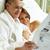 lezing · bed · echtpaar · krant · vrouw · papier - stockfoto © pressmaster