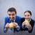 aantrekkelijk · jonge · vrouw · permanente · eten · hamburger · witte - stockfoto © pressmaster