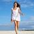 nő · fehér · ruha · sétál · tengerpart · lábak · kék - stock fotó © pressmaster