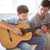 portré · fiatal · srác · játszik · akusztikus · gitár · otthon · zene - stock fotó © pressmaster