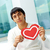 man with paper heart stock photo © pressmaster