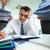 ocupado · de · trabajo · perplejo · contador · financieros · informes - foto stock © pressmaster