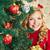 christmas · obecnej · uśmiechnięty · kobiet · patrząc · kamery - zdjęcia stock © pressmaster
