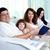 amistoso · familia · jóvenes · cuatro · sesión · sofá - foto stock © pressmaster
