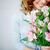 frissesség · közelkép · mosolyog · női · rózsaszín · virágok - stock fotó © pressmaster