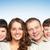család · fiatal · négy · néz · kamera · mosolyog - stock fotó © pressmaster