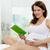 donna · libro · foto · felice · donna · incinta · guardando - foto d'archivio © pressmaster