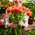 mosolygó · nő · köteg · virágok · kéz · arc · nők - stock fotó © pressmaster
