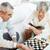 pareja · de · ancianos · jugando · ajedrez · casa · mujer · sonriente · ganar - foto stock © pressmaster