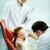 amistoso · masculina · dentista · ayudante · sonriendo · paciente - foto stock © pressmaster
