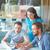 dizüstü · bilgisayar · kullanıyorsanız · toplantı · grup · üç · başarılı · İş · ortaklarımız - stok fotoğraf © pressmaster