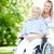 senior · mulher · cadeira · de · rodas · espaço · idoso · rir - foto stock © pressmaster