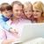 cztery · osoby · lobby · wskazując · laptop · uśmiechnięty · zespołu - zdjęcia stock © pressmaster
