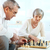 pareja · de · ancianos · jugando · ajedrez · altos · mujer · marido - foto stock © pressmaster