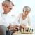 retrato · ancianos · Pareja · jugando · ajedrez · casa - foto stock © pressmaster