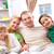 привязанность · молодые · счастливая · семья · четыре · глядя - Сток-фото © pressmaster