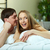 кровать · счастливым · женщину · человек - Сток-фото © pressmaster