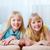 zorgeloos · tweelingen · portret · gelukkig · meisje · lopen · beneden - stockfoto © pressmaster