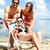 tengerpart · vakáció · pár · megnyugtató · napozás · nyár - stock fotó © pressmaster
