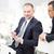 2 · ビジネスマン · 見える · デジタル · タブレット · 笑みを浮かべて - ストックフォト © pressmaster
