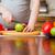 jonge · vrouw · oranje · ontbijt · keuken · badjas - stockfoto © prg0383