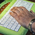 Close up of old male hand on keyboard stock photo © Pruser