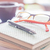 Pen and eyeglasses on three notebooks in coffee shop stock photo © punsayaporn