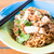 spicy stir fried noodles with crispy pork and chopstick stock photo © punsayaporn
