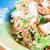 spicy stir fried noodles with crispy pork stock photo © punsayaporn