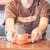 barista offering mini orange cup of coffee stock photo © punsayaporn