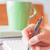 hand writing with green mug background stock photo © punsayaporn