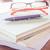 Pen and eyeglasses on three notebooks stock photo © punsayaporn
