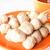 Mini pork balls in orange dish on clean table stock photo © punsayaporn